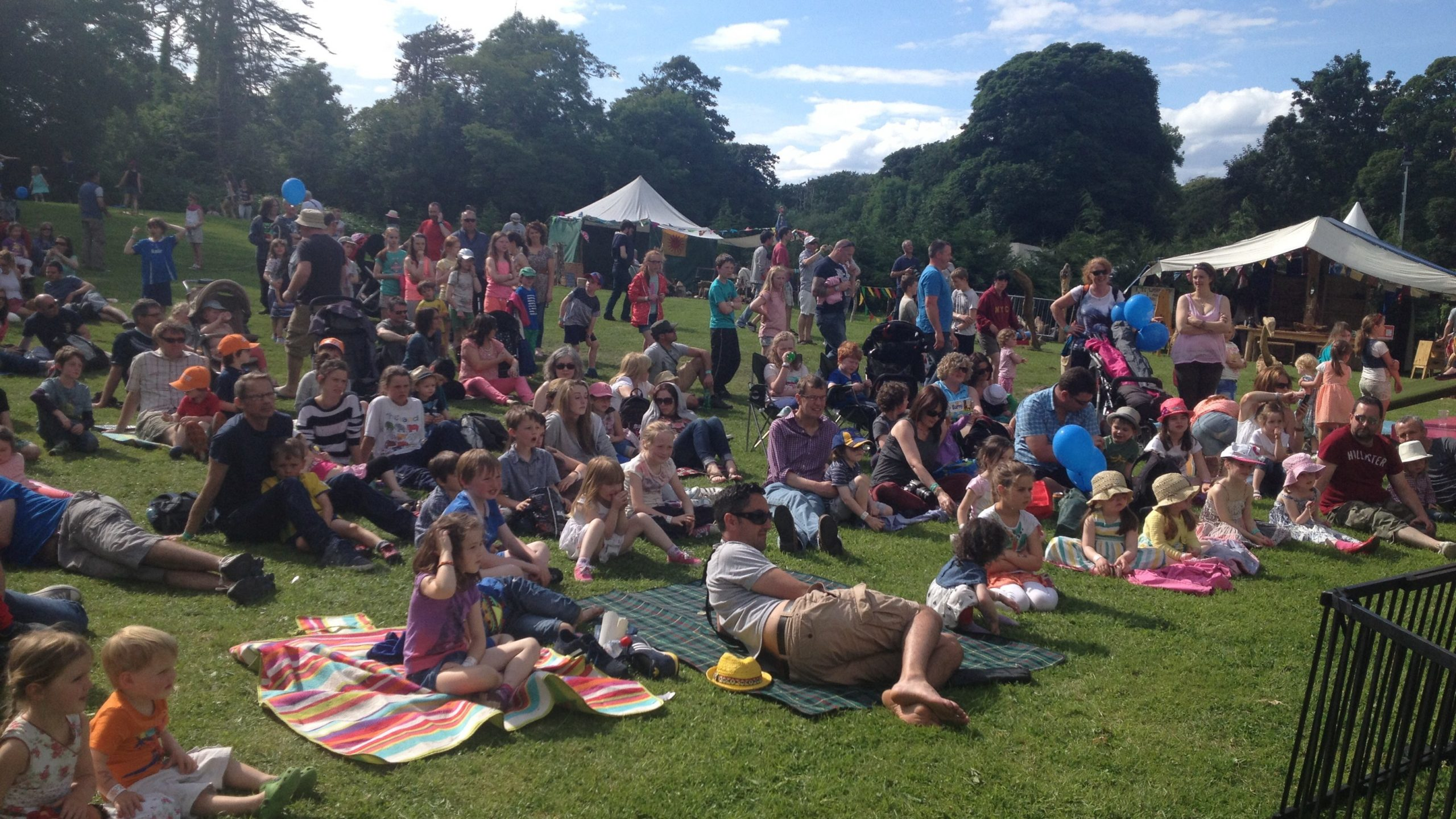 Photograph of the audience at the Wesport Festival enjoying the Moon & Sixpence Puppet Theatre
